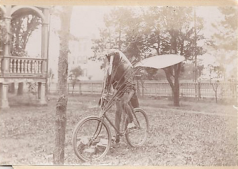 unexplained photo odd alien on a bike