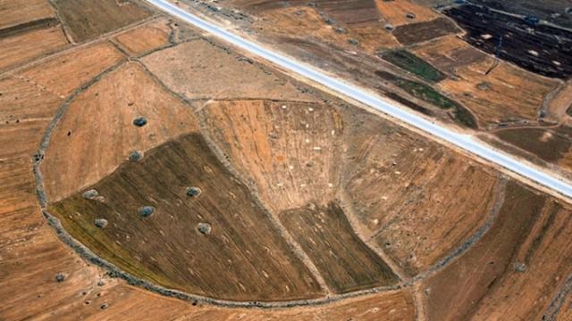Road cuts through ancient circle