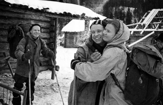 Yuri Yudin hugging Lyudmila Dubinina as he prepares to leave the group due to illness, as Igor Dyatlov looks on. Photo taken from a roll of film found at the camp of the Dyatlov Pass incident and annexed to the legal inquest that investigated the deaths.