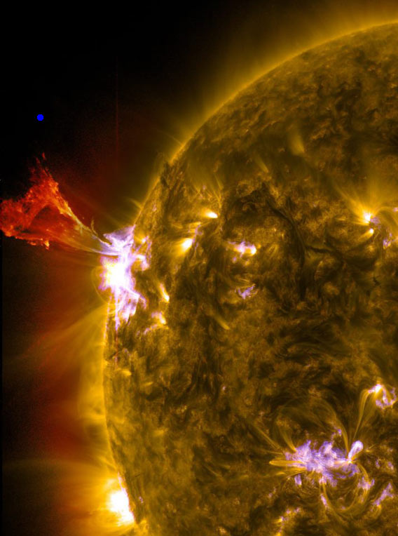 A burst of solar material leaps off the left side of the sun in what's known as a prominence eruption.  The blue dot is the size of Earth in comparison. This image combines three images from NASA's Solar Dynamics Observatory captured on May 3, 2013, at 1:45 pm EDT, just as an M-class solar flare from the same region was subsiding. The images include light from the 131-, 171- and 304-angstrom wavelengths. Credit: NASA/SDO/AIA