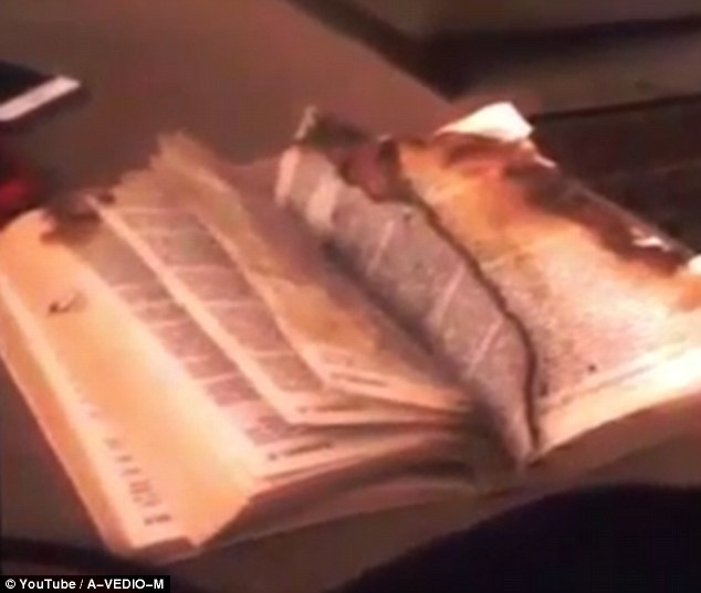 Is this a demon turning the pages of a scorched Bible?
